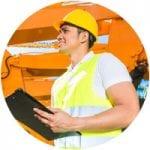 Heavy equipment worker writing on clipboard