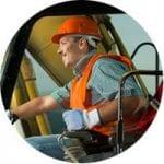 Operator working in machine cab.